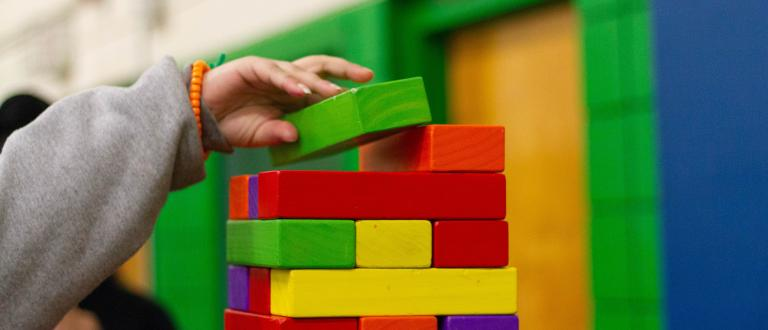 Colourful blocks being stacked