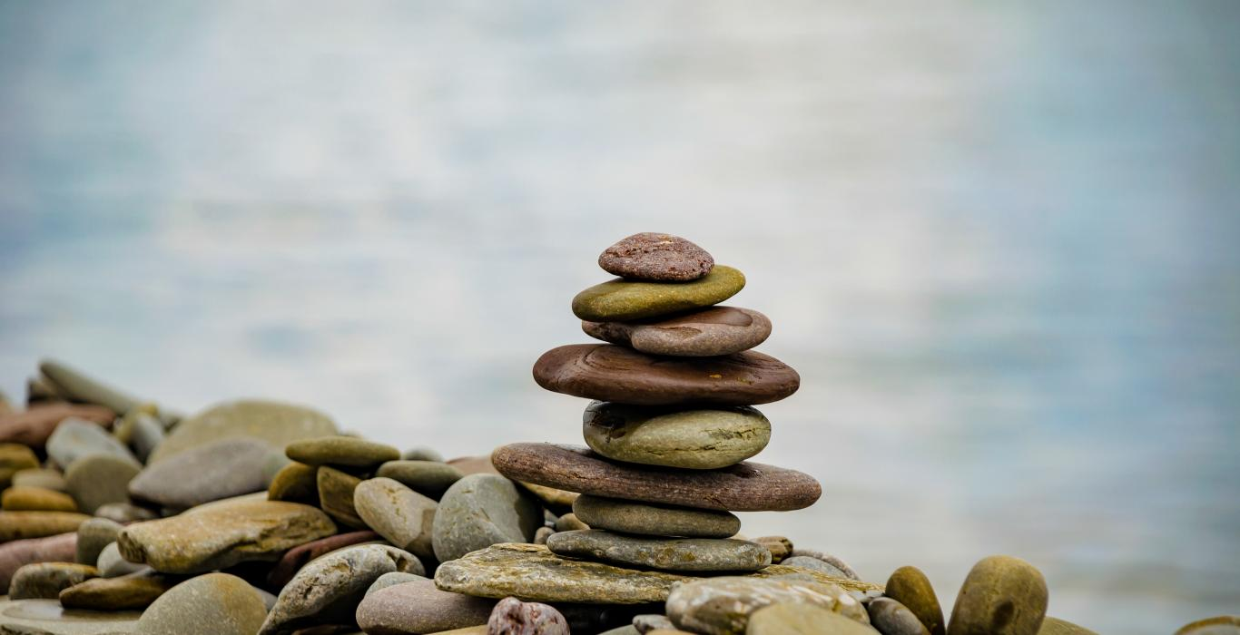 A stack of flat stones by water